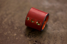 Hand-dyed vegetable tanned leather ring in custom made red color with edge painting