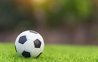 Soccer%20ball%20on%20grass%20green%20field%20with%20copy%20space_edited.jpg