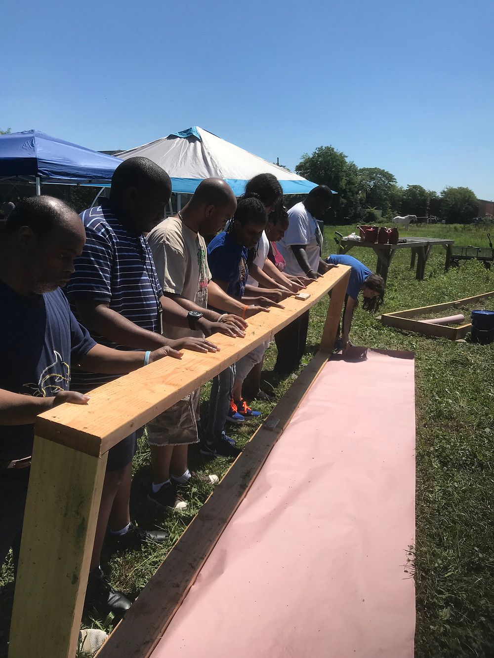SpArc participants and staff creating their produce garden bed.