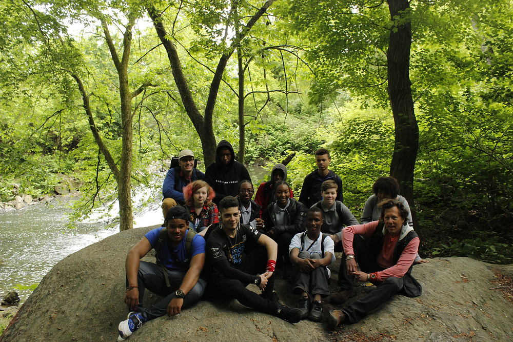 The 2019 Philadelphia Watershed Stewards and LHI Staff next to the waterfall in Haddington Woods.