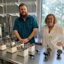 Jay Tuggle, Engineer (left) with Sue Mecham, CEO (right) with crossflow.