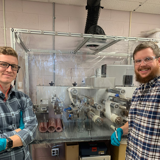 Michael Mecham, Lab Technician (left) and Jay Tuggle, Engineer (right) with the new coater.