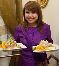 Food service in Thai costume