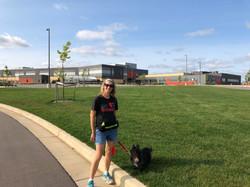 Rocco taking Jen Maier on a walk