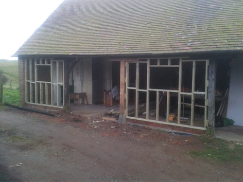 Replacement centre post and studwork for weatherboarding to barn/workshop. Muswell Hill Farm, Brill, Oxon