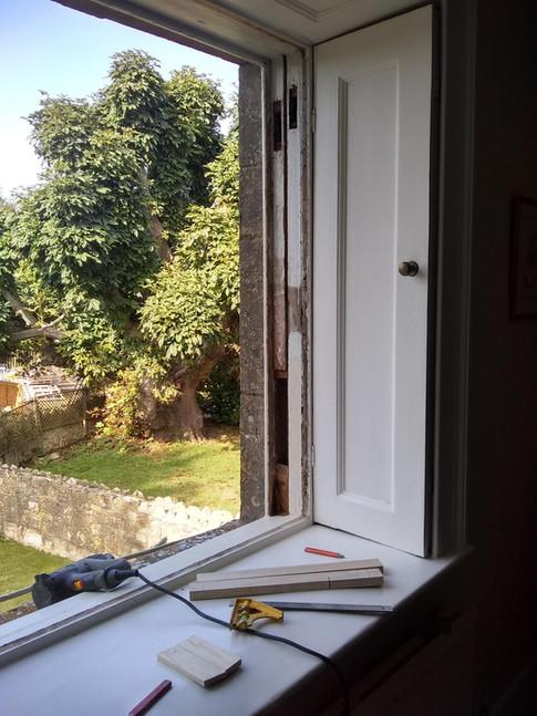 Restoration of sash window in progress, Manor House, Oxfordshire