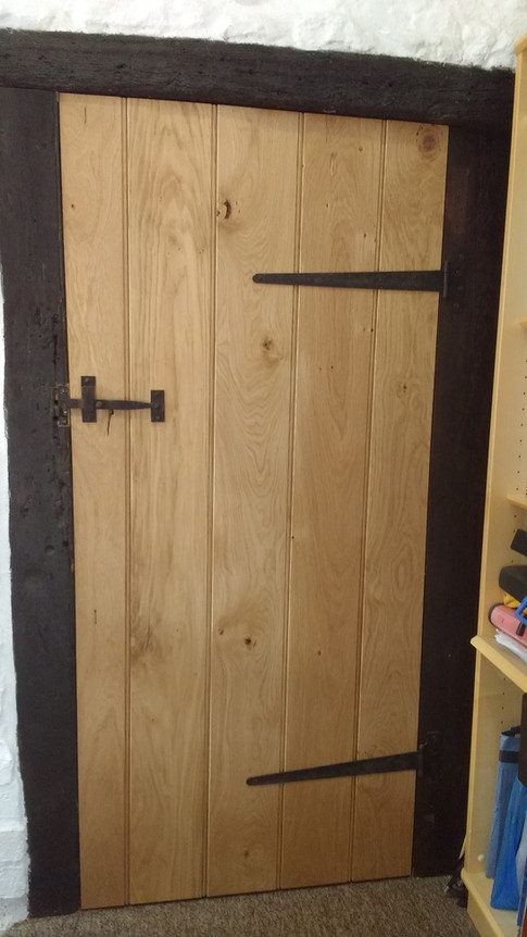 Made to measure oak ledge and brace door, scribed to fit. The old forge, Brill, Bucks.