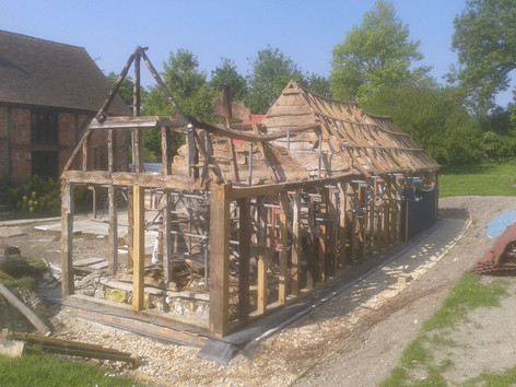 Listed barn frame restoration in progress. Meadle, Bucks