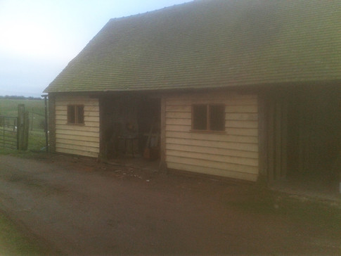New centre post and oak weatherboarding to barn/workshop. Muswell Hill Farm, B