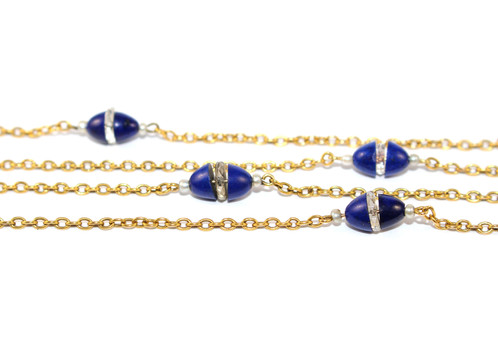 eced74f51 A stylish long gold trace chain set with carved lapis and facetted rock  crystal torpedos. Each torpedo has a seed pearl set to either side.