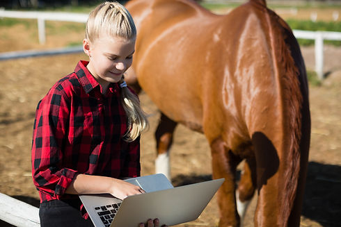 Girl using laptop at the ranch.jpg
