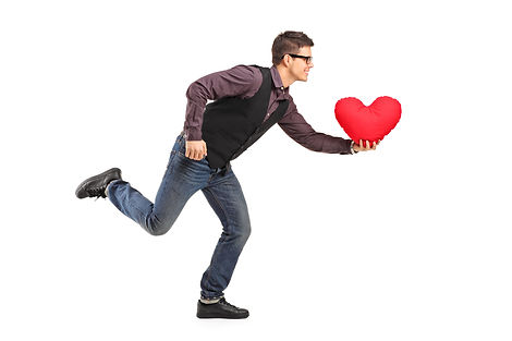 A young man running with a red heart sha