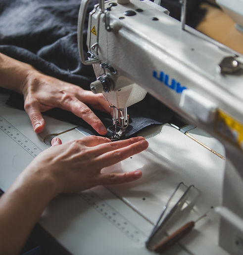 sewing-some-fabric-with-machine.jpg