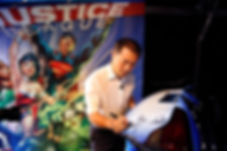 Jim Lee drawing Superman on special car at DC Exhibit at ComicCon