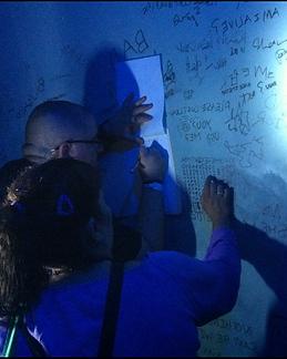Solving Clues at AHS Escape the Asylum event