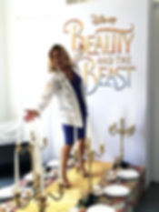 Cat Cora poses on Beauty and the Beast Photo Opportunity