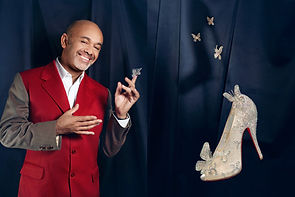 Christian Louboutin with his Cinderella Slipper