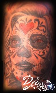 Tattoo realistic muerta portrait on a woman's arm.