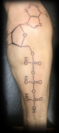 Tattoo of a chemical molecule on a man's calf.