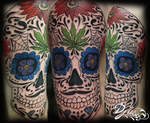 Tattoo of a skull of Mexican death. Mexican sugar skull. Canabis leaf.