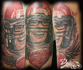 Tattoo of a portrait of a deceased or dead football player. Remembering a mother.