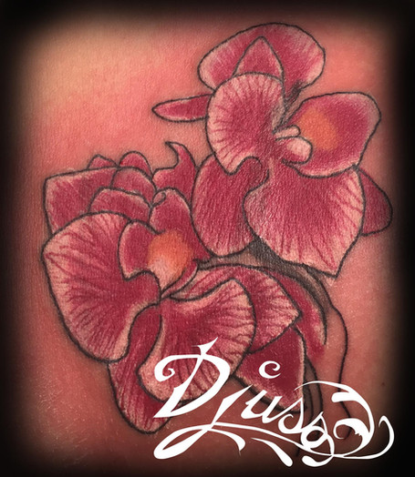 Orchid tattoo on a woman's arm.