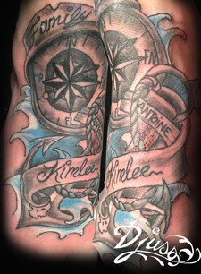 Marine foot tattoo. Boat and compass anchor tattoo on a woman's foot.