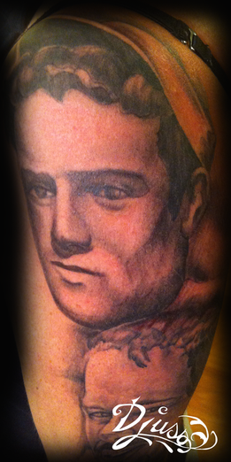 Tattoo of a portrait of a dead or dead brother.