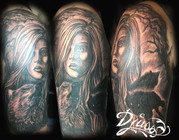 Tattoo of a realistic portrait of a woman among wolves with realistic howling wolf and wolf silouettes.
