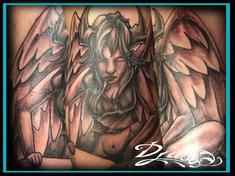 Tattoo of a devilish horned angel meditating.
