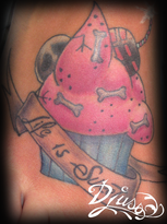 Tattoo of an eagle cover0-up with a bigger tattoo Tattoo of a cupcake cake on a woman's foot.