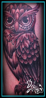 Tattoo of a neotrad owls on the arm of a man.