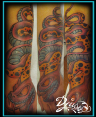 Tattoo of a neotrad snake on the forearm of a woman