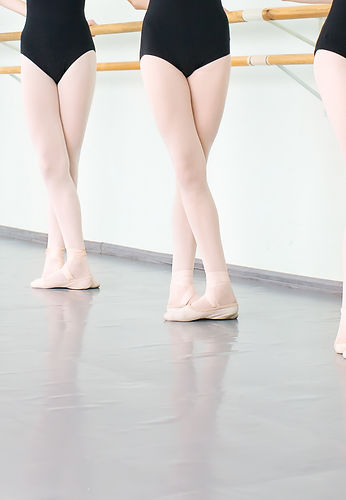 legs of young dancers ballerinas in clas