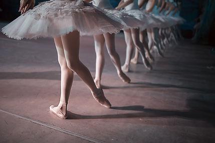 Dancers in white tutu synchronized danci