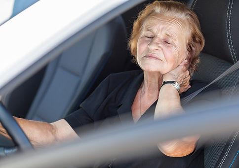 Elderly woman behind the steering wheel of a car_edited.jpg