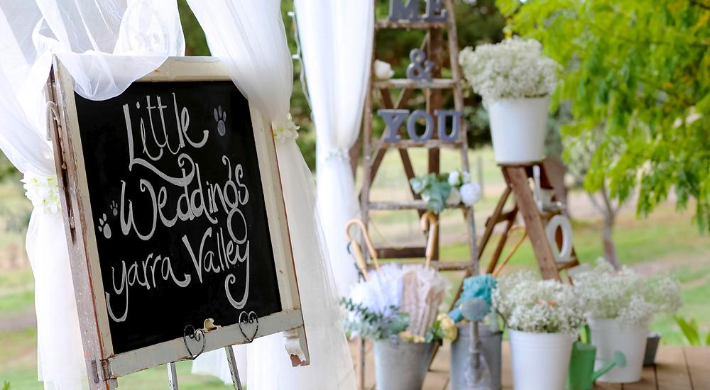 little weddings yarra valley blackboard with flowers