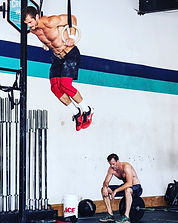 Chef Julian Martinez doing ring muscle-ups at CrossFit gym
