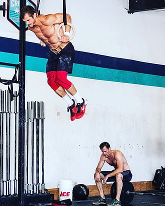 Chef Julian Martinez doing CrossFit muscle-ups