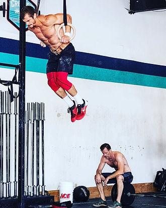 Chef Julian Martinez doing CrossFit muscle-ups