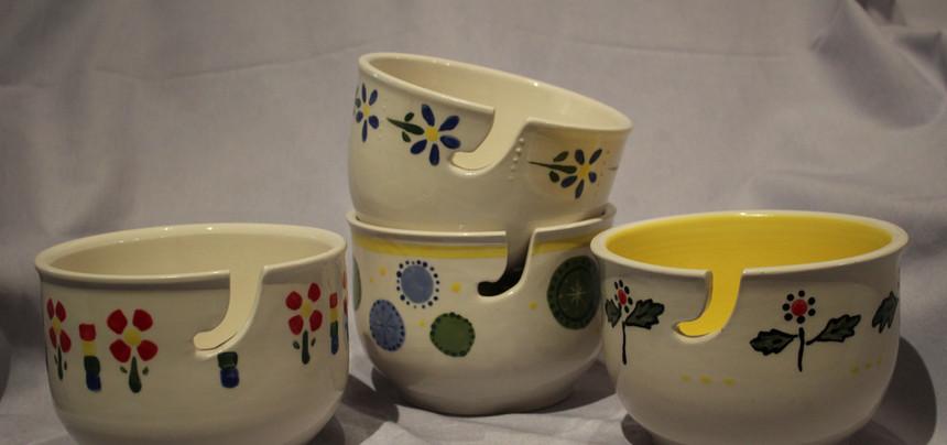 Set of colorful yarn bowls for commission