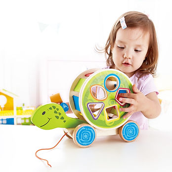 A Baby is playing with Rental Toy