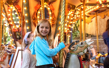 Child enjoying the Carousel