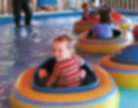 Little boy in Kiddy Bumper Boats