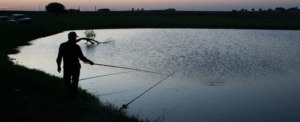 Dusk is a great time for relaxing with a fishing pole in your hand.