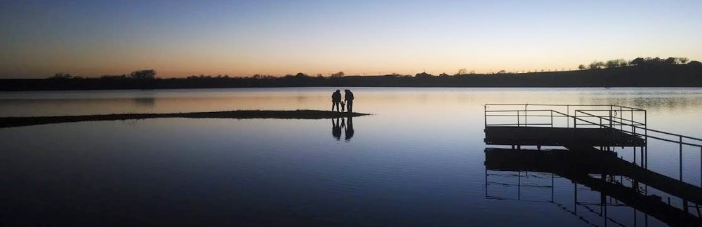 Watching the sun set at your own lake can make for some high-quality family time.