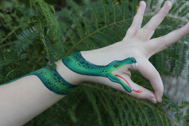 Green snake hand and arm painting