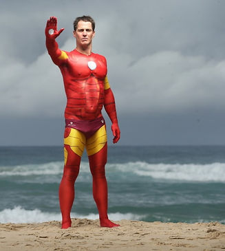 Shannon Eckstein painted as Marvel's Iron Man for the Courier Mail. Body painting by Brisbane artist Beth Joyce.