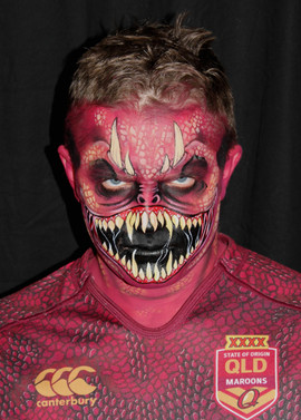 Maroon Monster face painting with horns and lots of teeth