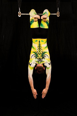 Shades of green and gold with black tribal detail Cirque du soleil inspired full body painting